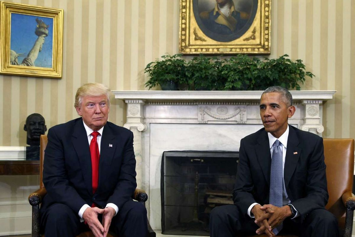 US President Barack Obama (right) meets with President-elect Donald Trump to discuss transition plans in the White House Oval Office in Washington, US on Nov 10, 2016.
