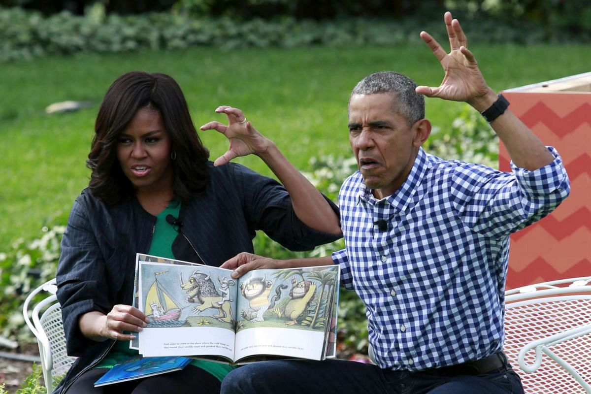 US President Barack Obama and first lady Michelle Obama perform a reading of the children's book Where The Wild Things Are for children gathered for the annual White House Easter Egg Roll on the South Lawn of the White House on March 28, 2016.