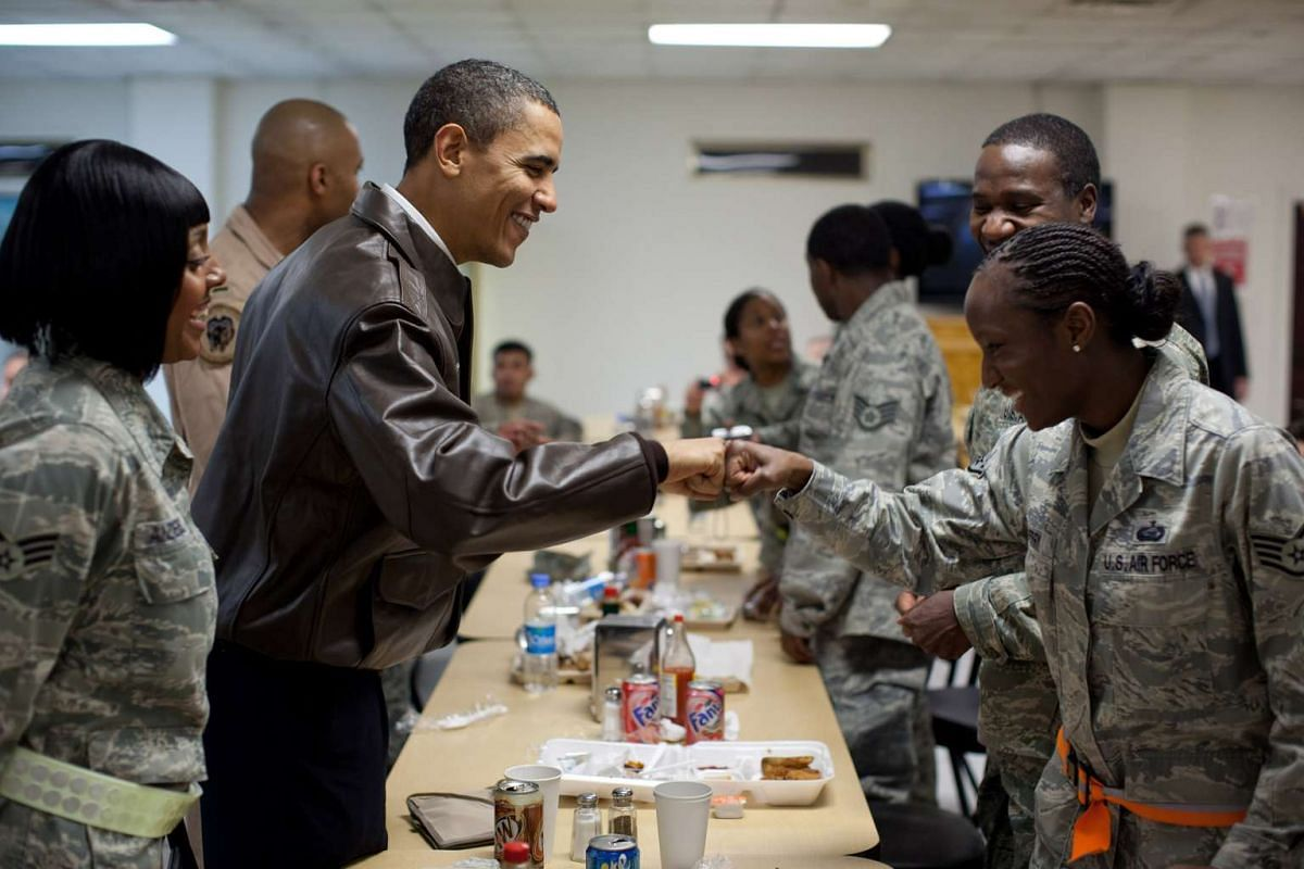 President Barack Obama greets US troops at a mess hall at Bagram Air Field in Afghanistan in March 2010. Mr Obama visited Afghanistan four times in his presidency. In eight years, he has spent almost seven months on foreign travel.
