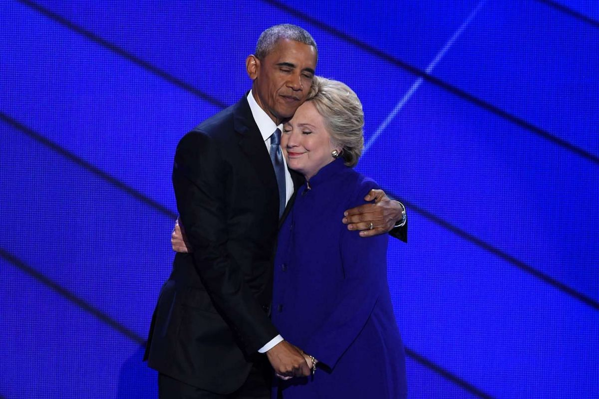 US President Barack Obama and Democratic presidential nominee Hillary Clinton embrace on stage during Day 3 of the Democratic National Convention at the Wells Fargo Center on July 27, 2016 in Philadelphia, Pennsylvania.