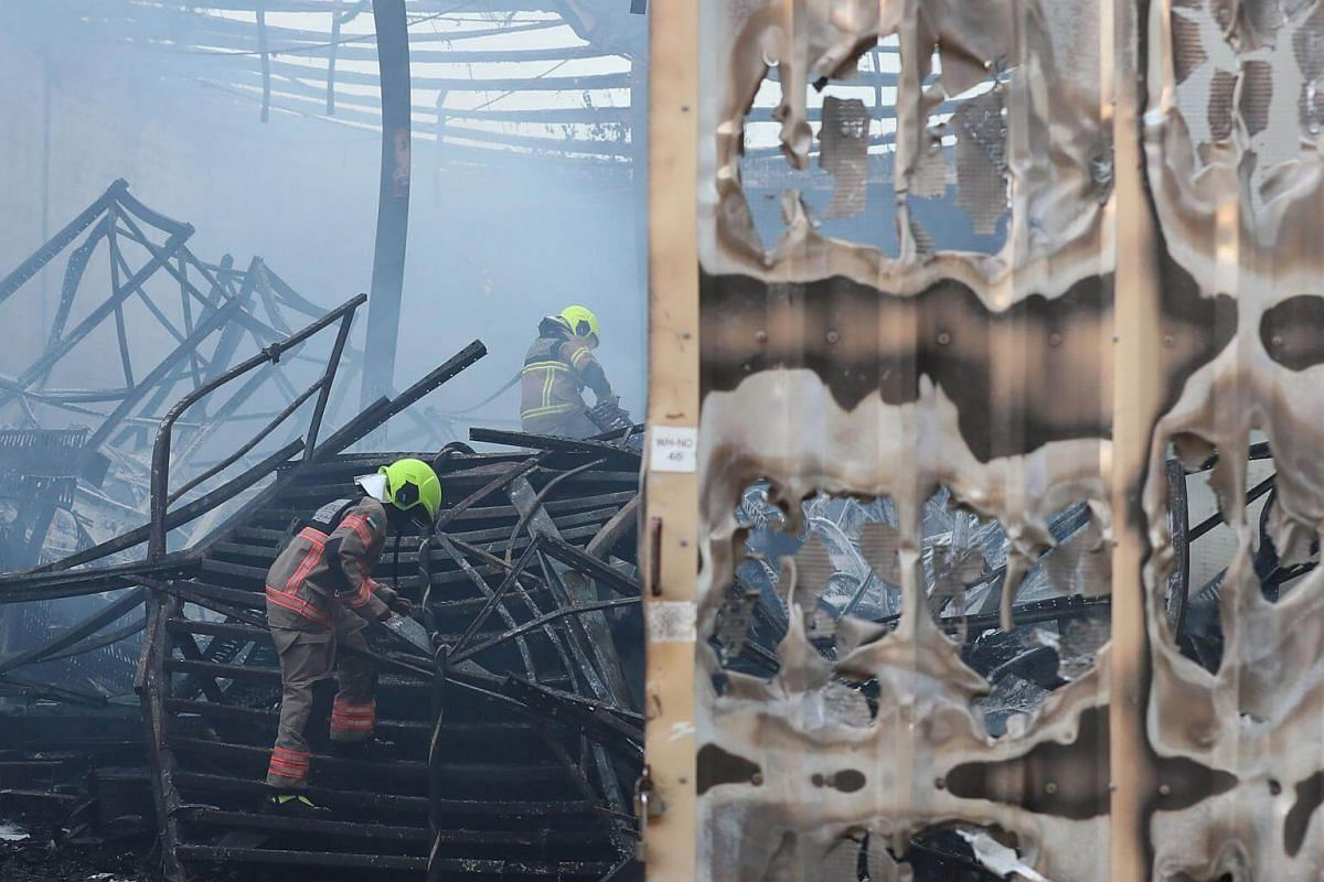 Emirati fire fighters extinguish a fire at a factory in Jabal Ali in Dubai.