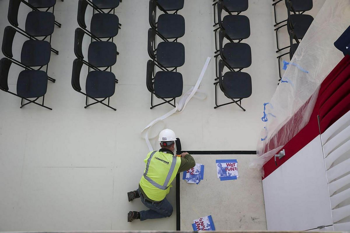 A worker prepares the inaugural platform in Washington, DC, on Jan 18, 2017.