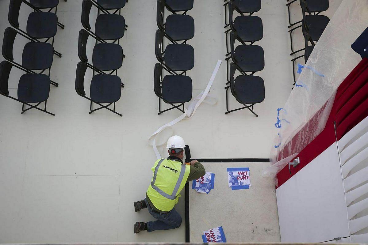 A worker prepares the inaugural platform in Washington, DC, on Jan 18, 2017.