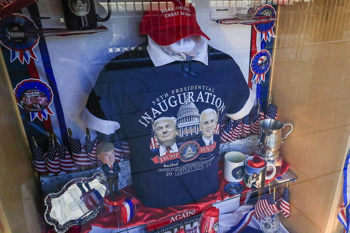 T-shirts and other memorabilia sit on display in a store window in advance of President-elect Donald Trump's inauguration in Washington, DC, on Jan 18, 2017.
