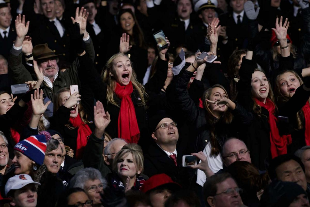 Audience members cheer for US President-elect Donald Trump on a stage at the Lincoln Memorial a day before swearing in as the 45th President of the United States, on Jan 19, 2017.