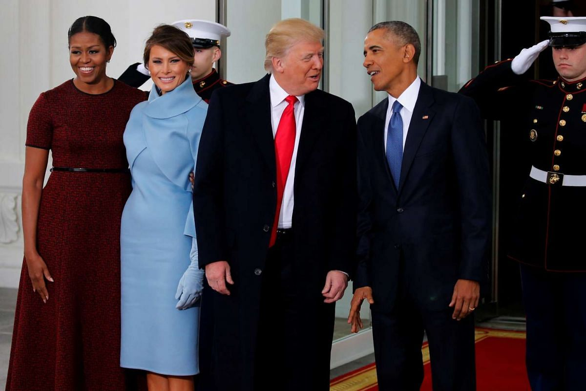 US President Barack Obama (right) and first lady Michelle Obama (left) greet US president-elect Donald Trump and his wife Melania for tea before the inauguration at the White House in Washington, US on Jan 20, 2017.