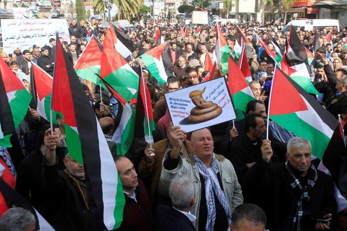 Palestinian demonstrators during a protest against a promise by Trump to re-locate US embassy to Jerusalem, in the West Bank city of Nablus, on Jan 19, 2017.