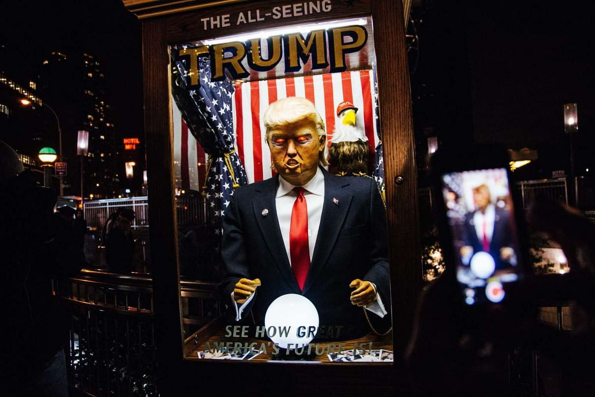 People gathering outside the Trump International Hotel and Tower in Midtown Manhattan in New York, US, on Jan 19, 2017, on the eve of the Presidential Inauguration.