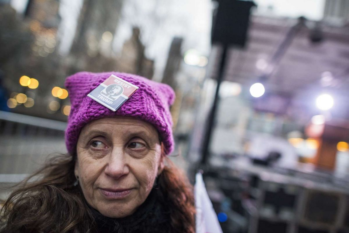 "Gail Prusslin wears her ""pussyhat"" at a protest rally outside the Trump International Tower on Columbus Circle in Manhattan, on the eve of the presidential inauguration on Jan 19, 2017."