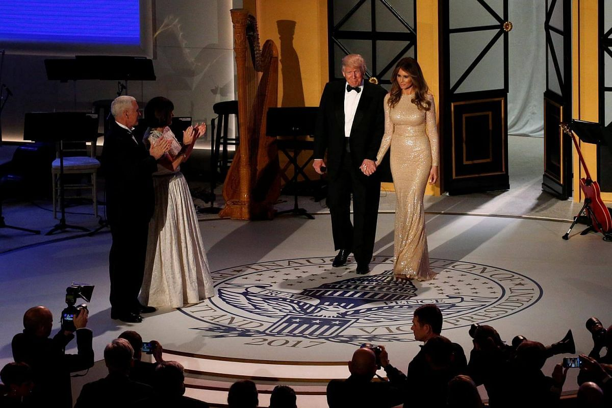 US President-elect Donald Trump and his wife Melania take the stage with Vice President-elect Mike Pence (left) and his wife Karen at a pre-inauguration candlelight dinner in Washington, US on Jan 19, 2017.