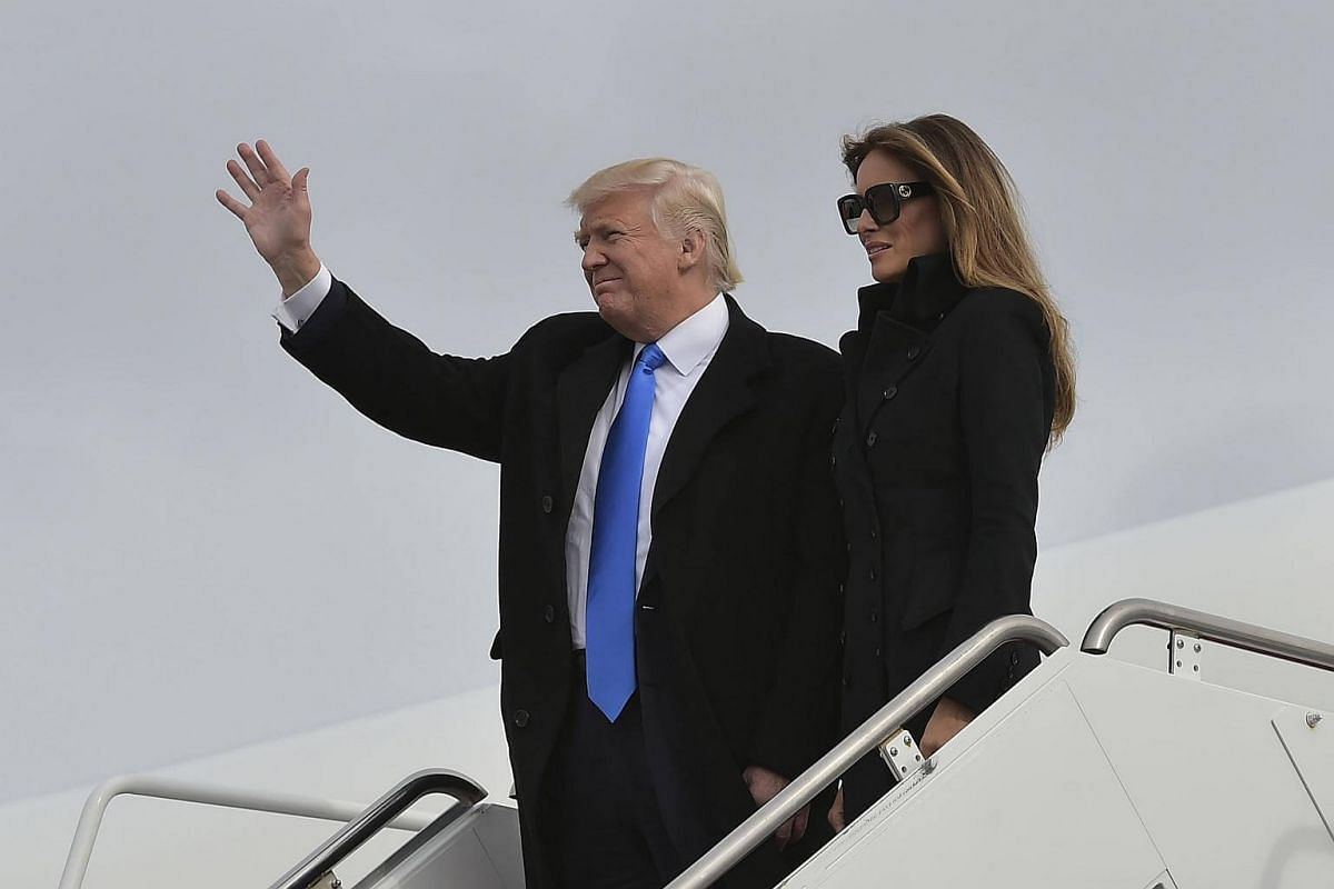 US President-elect Donald Trump and his wife Melania step off a plane upon arrival at Andrews Air Force Base in Maryland on Jan 19, 2017.