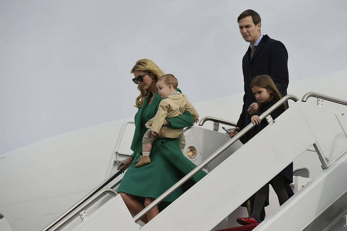 US President-elect Donald Trump's daughter Ivanka Trump, her son Theo, her husband Jared Kushner and daughter Arabella, step off a plane upon arrival at Andrews Air Force Base in Maryland on Jan 19, 2017.