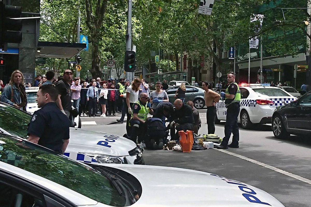 Police and emergency services at the scene after a car is believed to have hit pedestrians in Bourke Street Mall in Melbourne, Victoria, Australia.