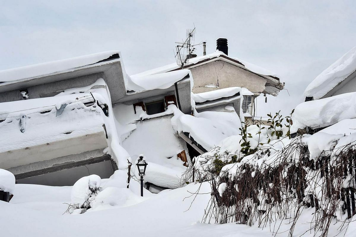 Rubble and debris of a destroyed building covered with snow are pictured in the damaged central Italian village of Amatrice, after a 5.7-magnitude earthquake struck the region.