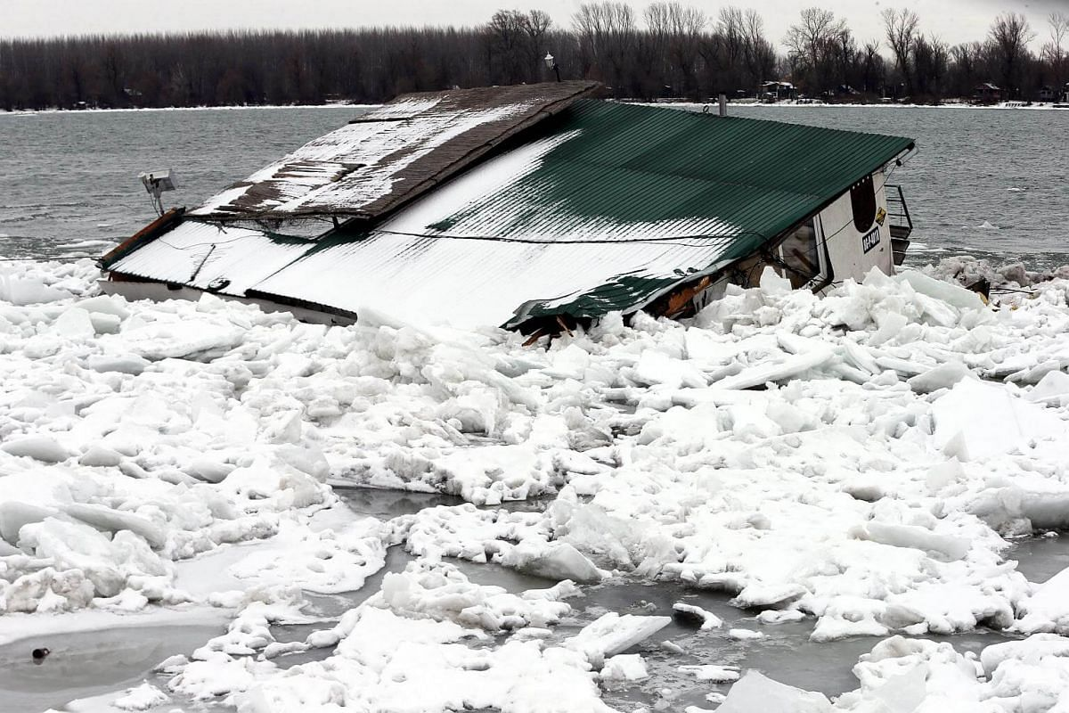 A boat is stuck in the frozen river Danube in Belgrade, Serbia.