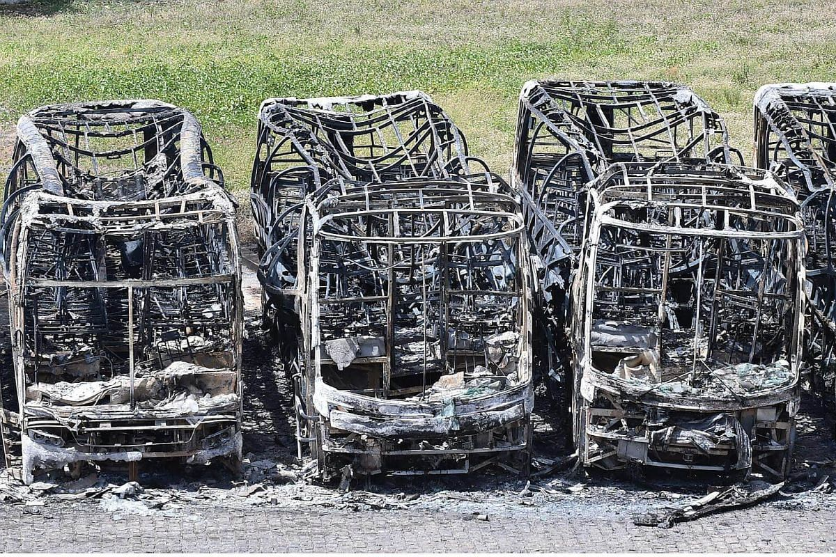 Buses burnt by people protesting against the transfer of inmates from the Alcacuz prison are seen in Natal, Rio Grande do Norte state, Brazil.