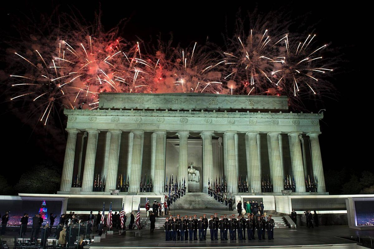 Fireworks explode over the Lincoln Memorial after a welcome celebration for US President-elect Donald Trump in Washington, DC.