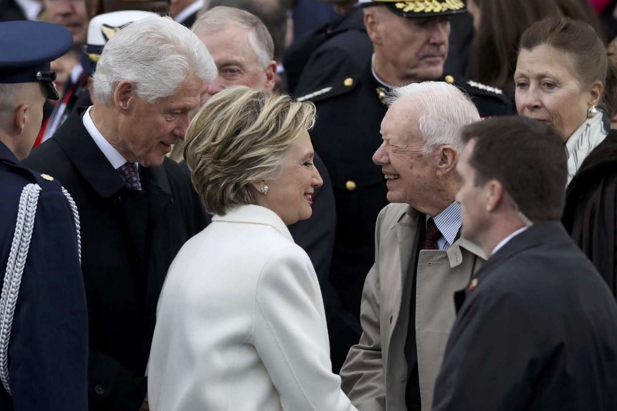 The Clintons greet former US president Jimmy Carter ahead of the inauguration ceremonies.