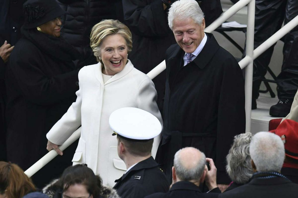 Mrs Clinton greets the public with her husband Bill at Capitol on Friday (Jan 20).