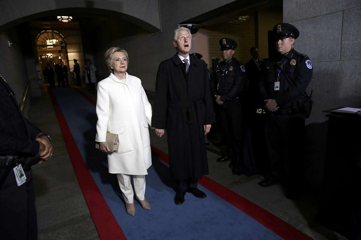 The 69-year-old arrives at the West Front of Capitol, with her husband Bill Clinton.