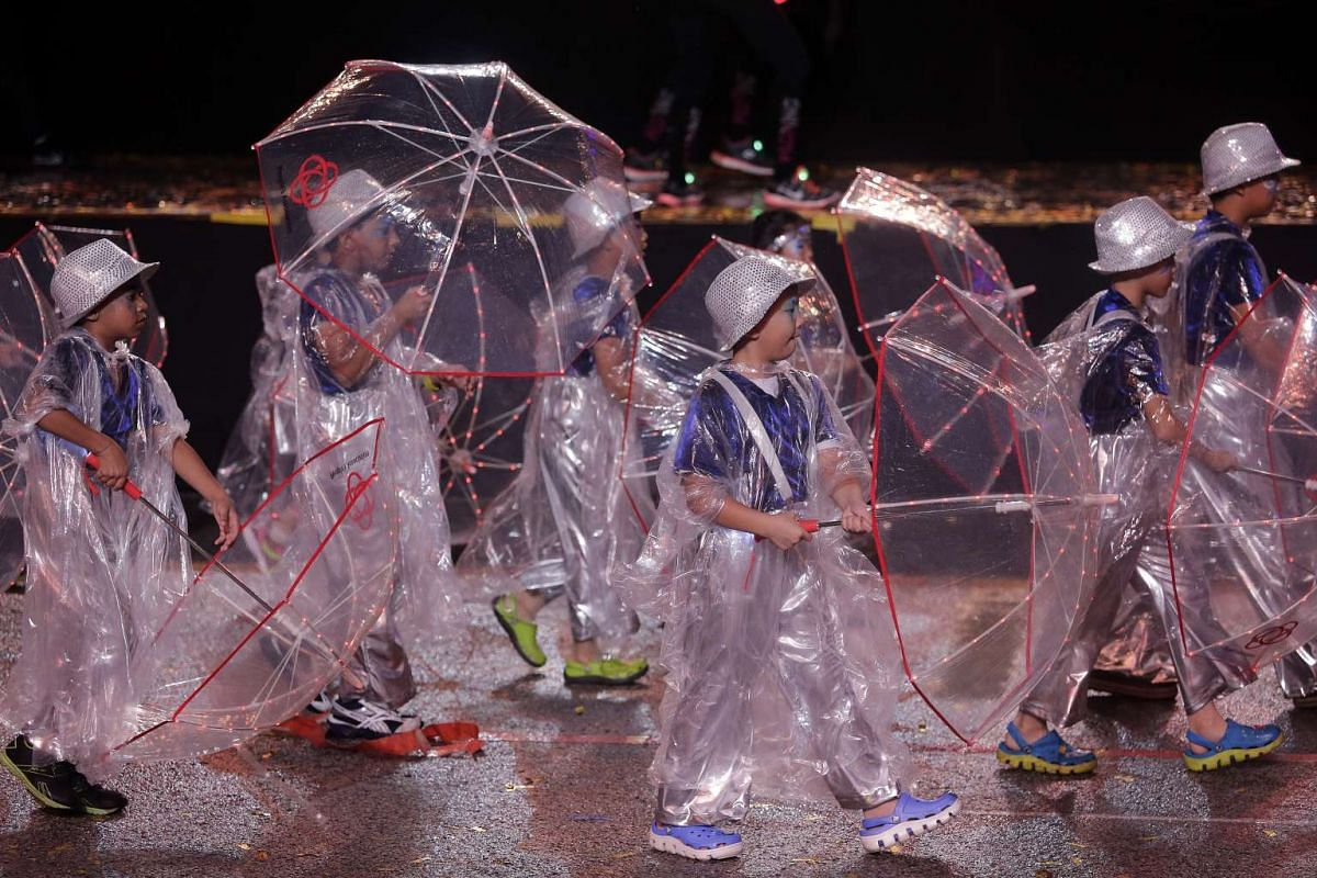 Members of the People's Association Youth Movement (PAYM) dressed for the weather in poncho costumes, inspired by the heavy downpour during last year's parade.