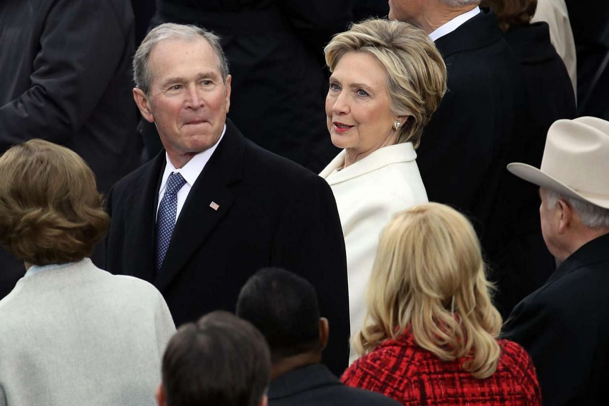 Former Democratic presidential nominee Hillary Clinton (right) talks to former US President George W. Bush on the West Front of the US Capitol on Jan 20, 2017.