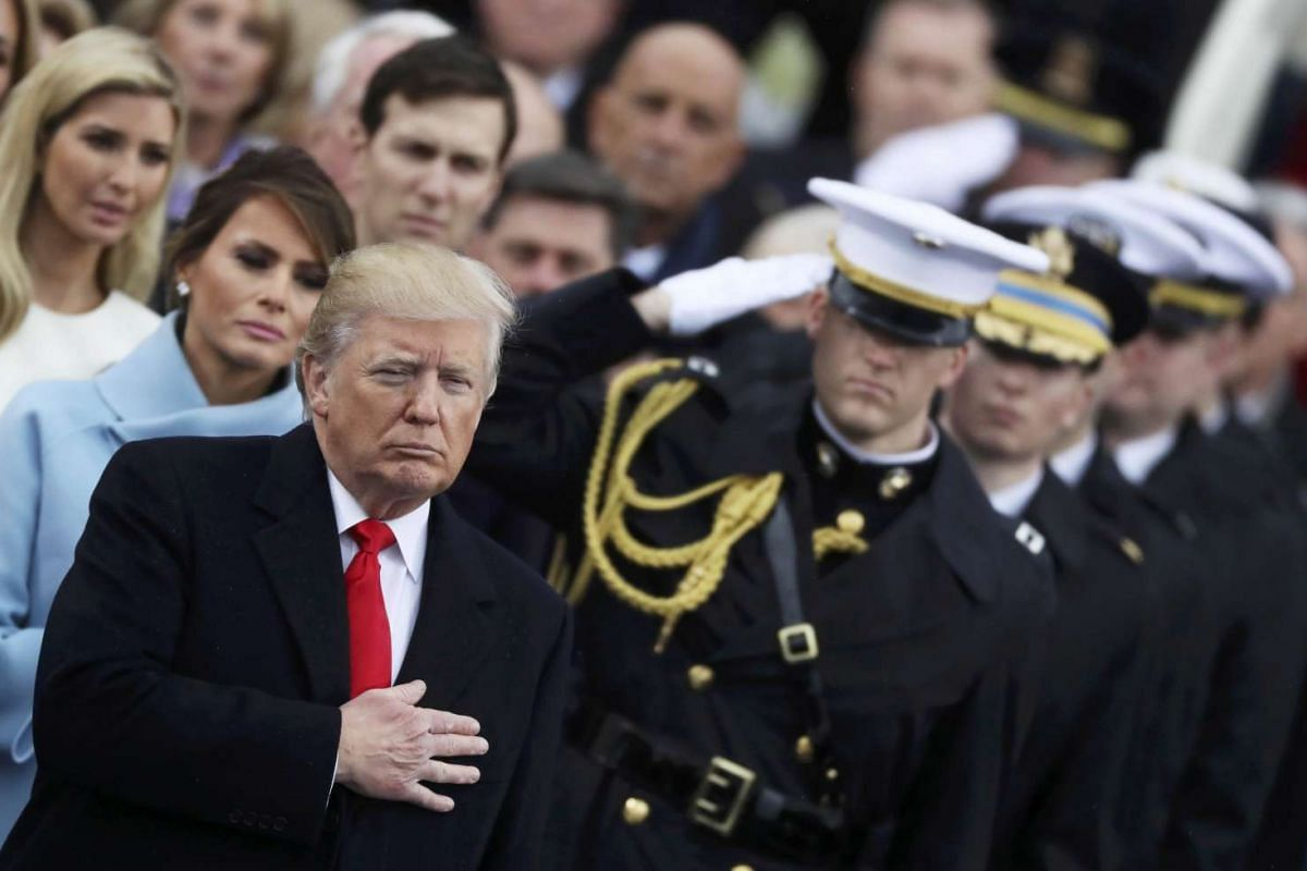 Donald Trump listens during the US national anthem on the West front of the US Capitol in Washington on Jan 20, 2017.