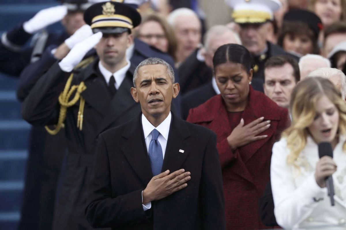 Former US president Barack Obama and former First Lady Michelle Obama listen during the US national anthem on the West front of the US Capitol in Washington on Jan 20, 2017.