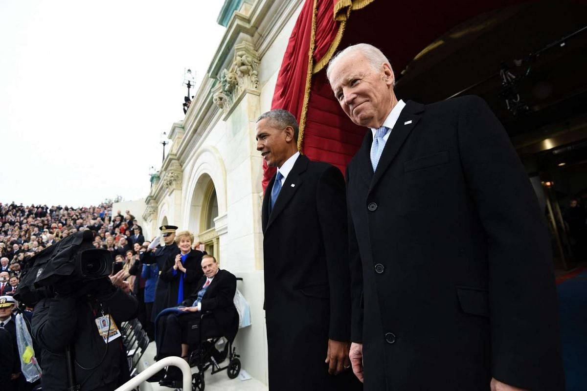 US President Barack Obama and Vice President Joe Biden arrive for the Presidential Inauguration of Donald Trump at the US Capitol in Washington, DC on Jan 20, 2017.