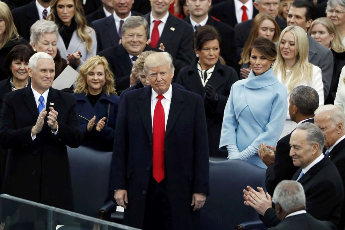 Donald Trump receives applause at the US Capitol in Washington, US on Jan 20, 2017.
