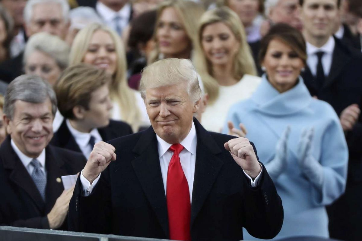 US President Donald Trump celebrates after being sworn in as the 45th president of the United States on the West front of the US Capitol in Washington on Jan 20, 2017.