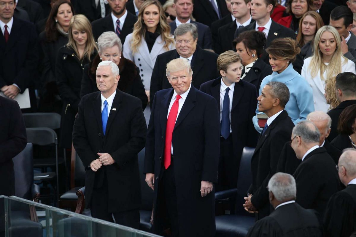 US President Donald Trump stands on stage with US Vice President Mike Pence during the 58th presidential inauguration in Washington, DC on Jan 20, 2017.