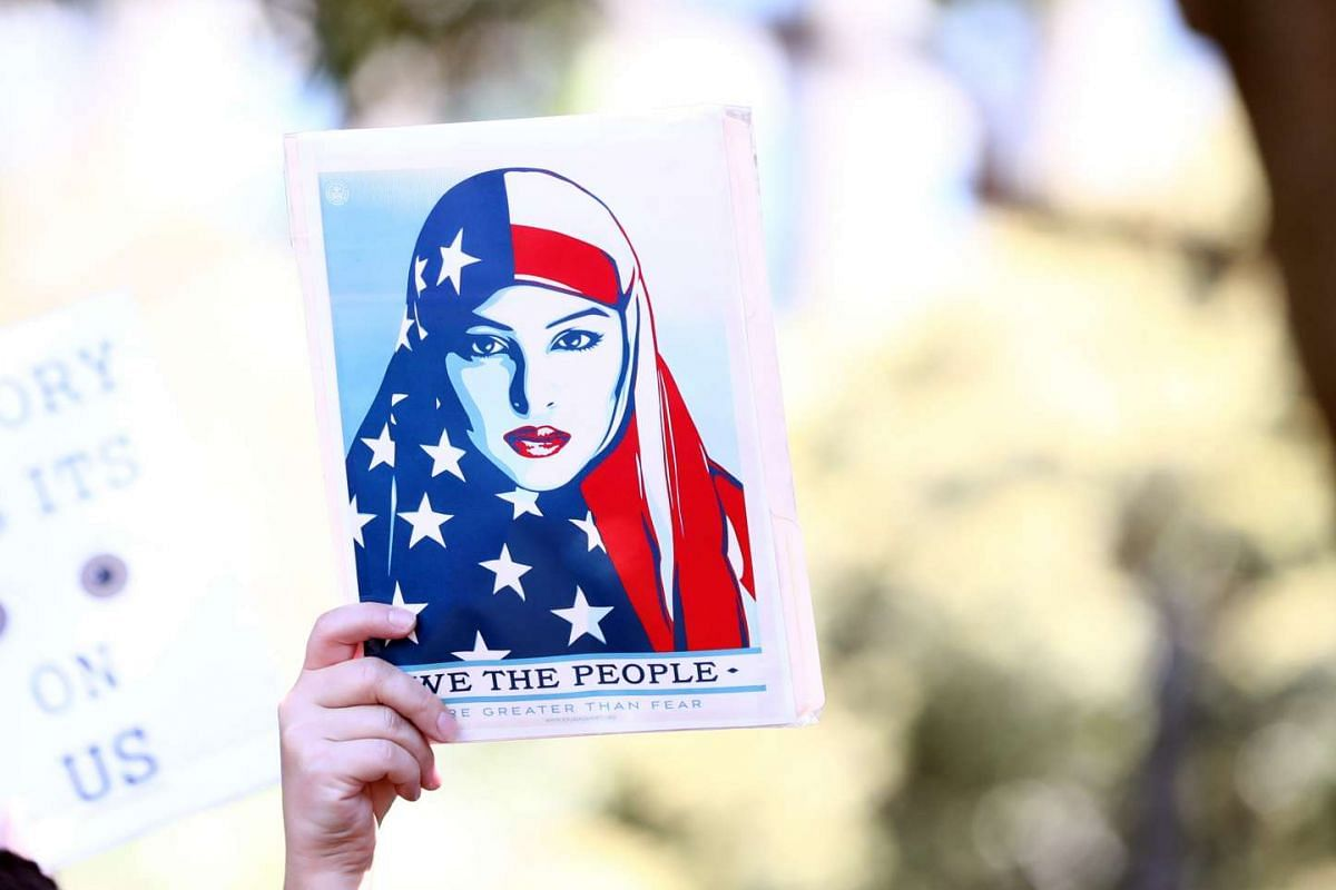 Women protestors march in a rally against US President Donald Trump following his inauguration, in Sydney on Jan 21, 2017.
