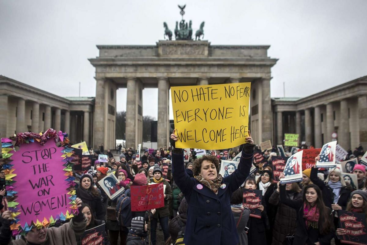 People protest in support of women's rights in front of the Brandenburg Gate in Berlin, Germany, on Jan 21, 2017.