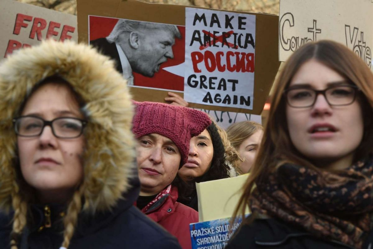 People take part in a rally in solidarity with supporters of the Women's March taking place in Washington and many other cities on Jan 21, 2017 in Prague, Czech Republic, one day after the inauguration of the US President.