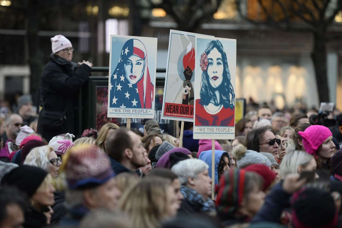 Protesters carrying placards take part in a Women's March in Stockholm, Sweden, on Jan 21, 2017, one day after the inauguration of the US President.
