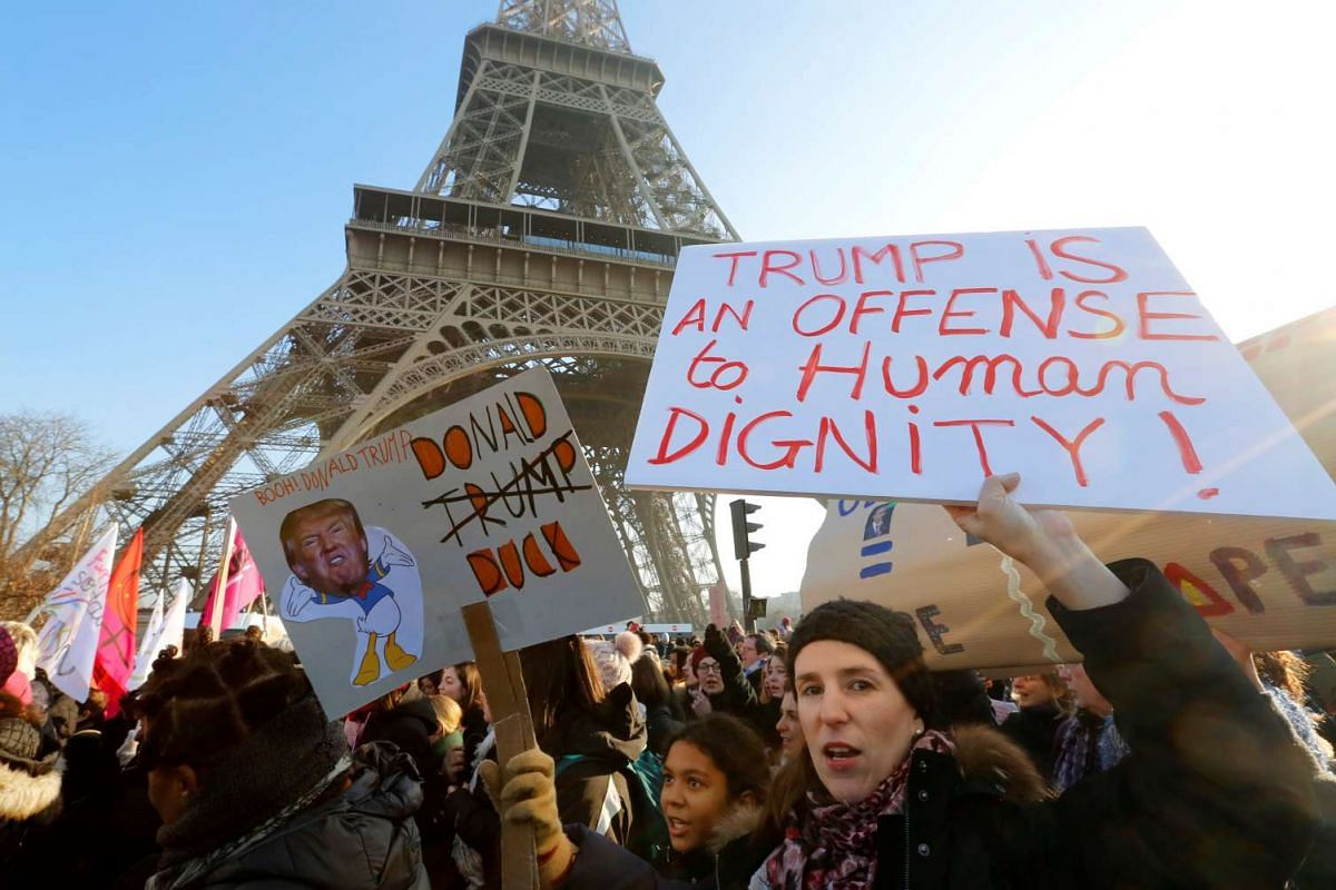 Protesters take part in the Women's March in Paris, France, Jan 21, 2017. The march formed part of a worldwide day of action following the election of Donald Trump to US President.