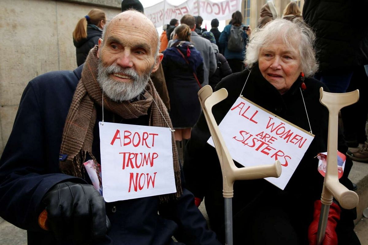 Protesters take part in the Women's March in Paris, France, Jan 21, 2017. The march formed part of a worldwide day of action following the inauguration of Donald Trump to US President.