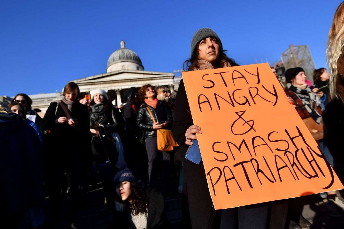 Protesters hold home made placards during the Women's March in Trafalgar Square in London on Jan 21, 2017 as part of a global day of protests against new US President Donald Trump.