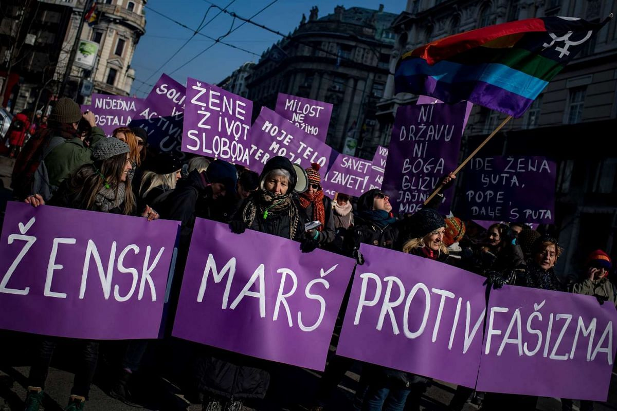 """People hold a banner which translates as """"Womens march against fascism"""" during a rally in solidarity with the Women's March taking place in Washington and many other cities on Jan 21, 2017 in Belgrade, Serbia."""