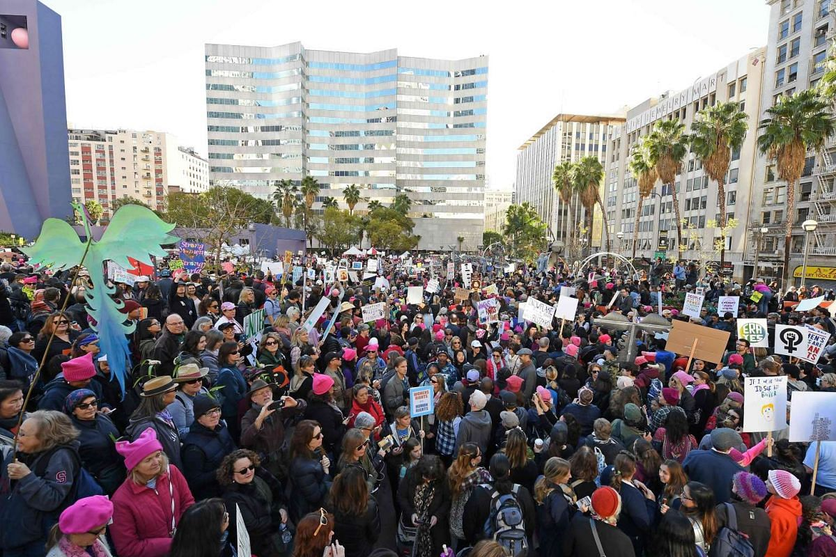 People rally and march in the Women's March on Jan 21, 2017, in Los Angeles.