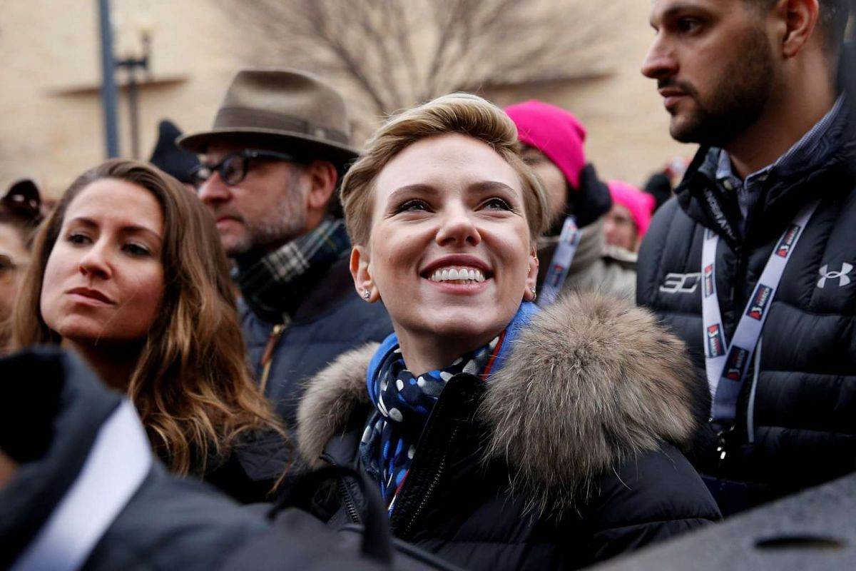 Actress Scarlett Johansson smiles at the Women's March in Washington, DC, on Jan 21, 2017.