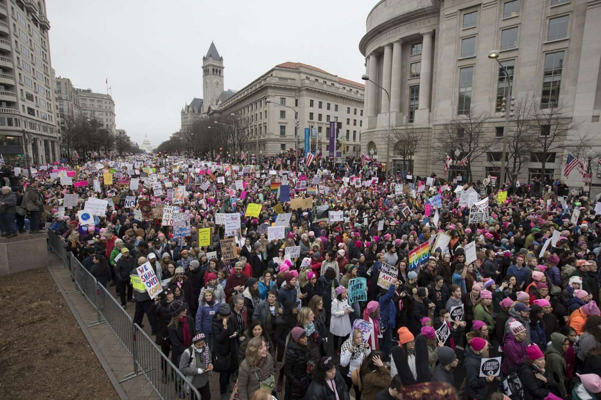 Protesters gather on Pennsylvania Avenue to protest Donald Trump's inauguration during the Women's March in Washington, DC, on Jan 21, 2017.