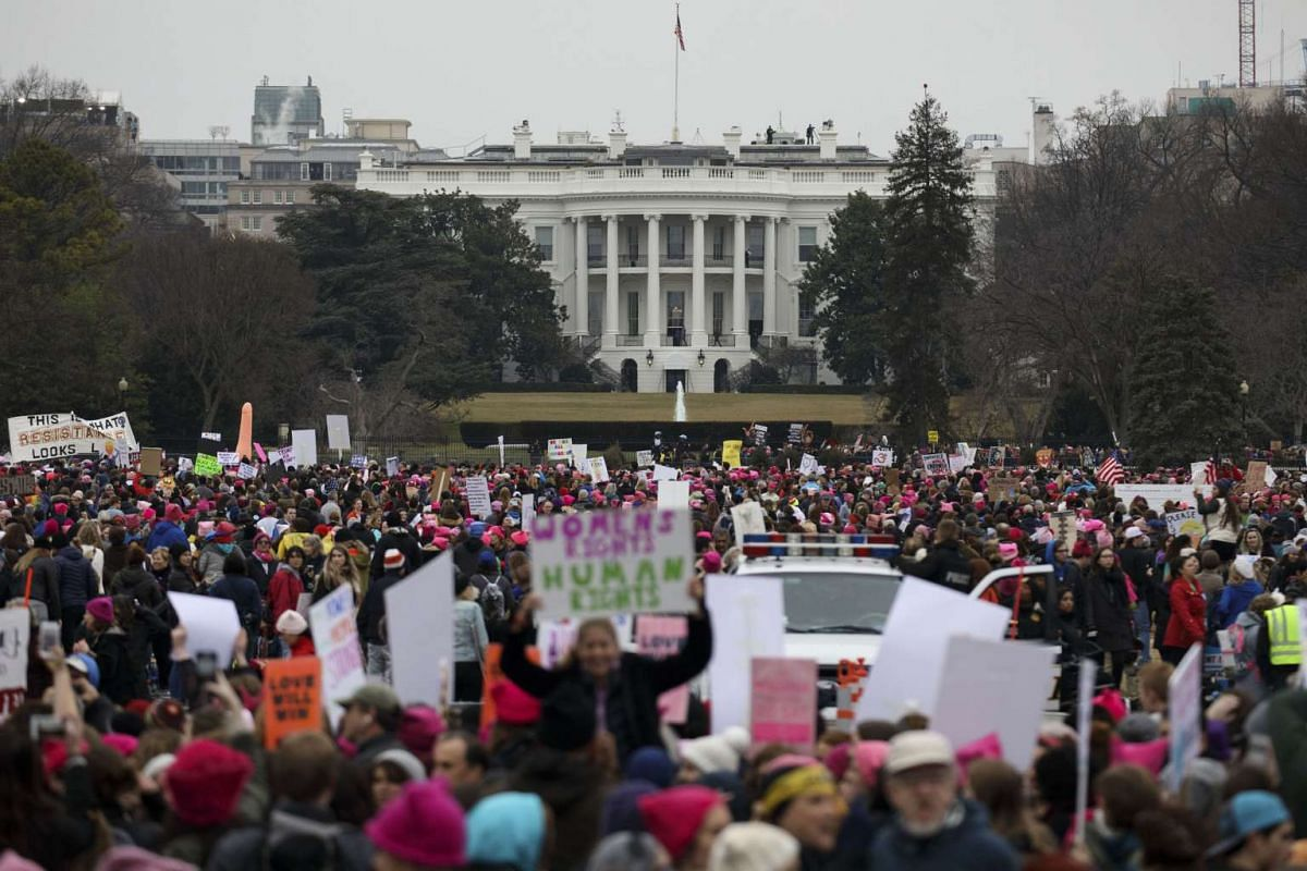 Demonstrators gather in front of the White House during the Women's March in Washington, DC, on Jan 21, 2017.