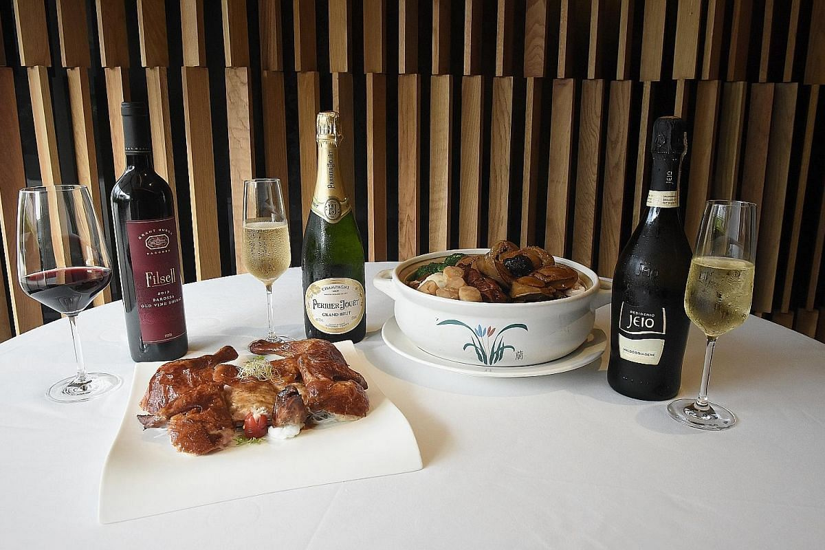 "Dual Style Roasted and Sze Chuan ""Bon Bon""' Chicken paired with Grant Burge Filsell Shiraz (left) from South Australia's Barossa Valley, and pen cai paired with either Champagne Perrier Jouet Grand Brut (centre) or Bisol Desiderio Jeio, Prosecco di V"