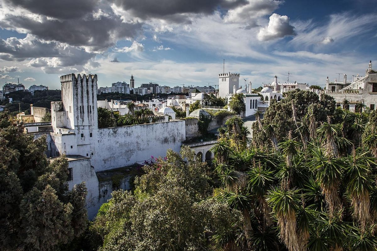 The city of Tangier (above) boasts both the ancient, such as the old walls of the medina (left), and the modern, in the form of new construction projects in the main city district. The city of Tetouan (far left) in northern Morocco and a souk (left)