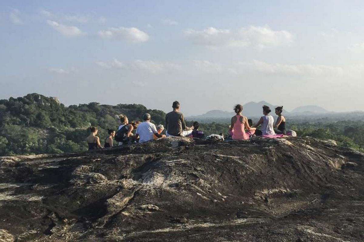A group afternoon meditation at Ulpotha yoga retreat in central Sri Lanka.