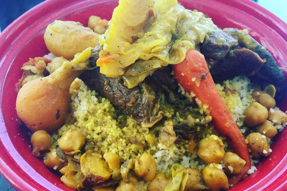 A meat tagine paired with cous cous, a staple dish found in Moroccan homes.
