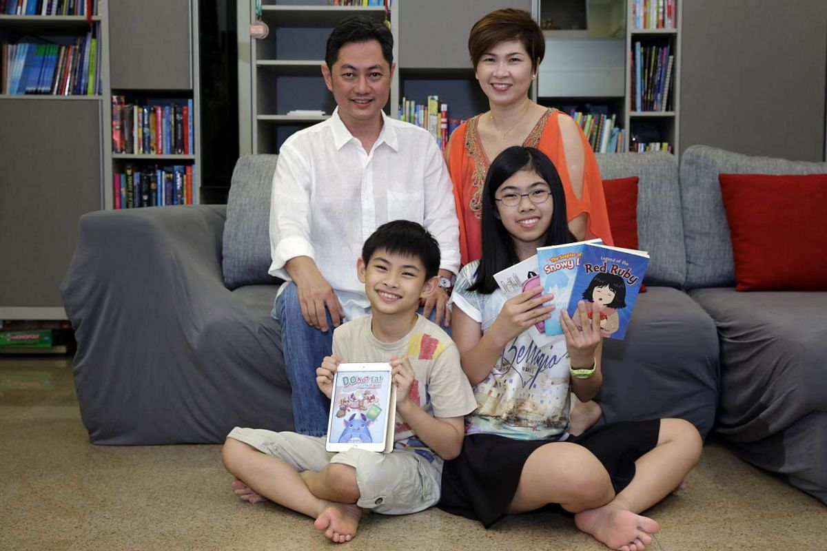 Mr Teguh Pranoto Chen and his wife, Madam Kimberly Thio, with their daughter, Lara Therrise, and son, Zeke Ignatius. The children are holding their self-published books.