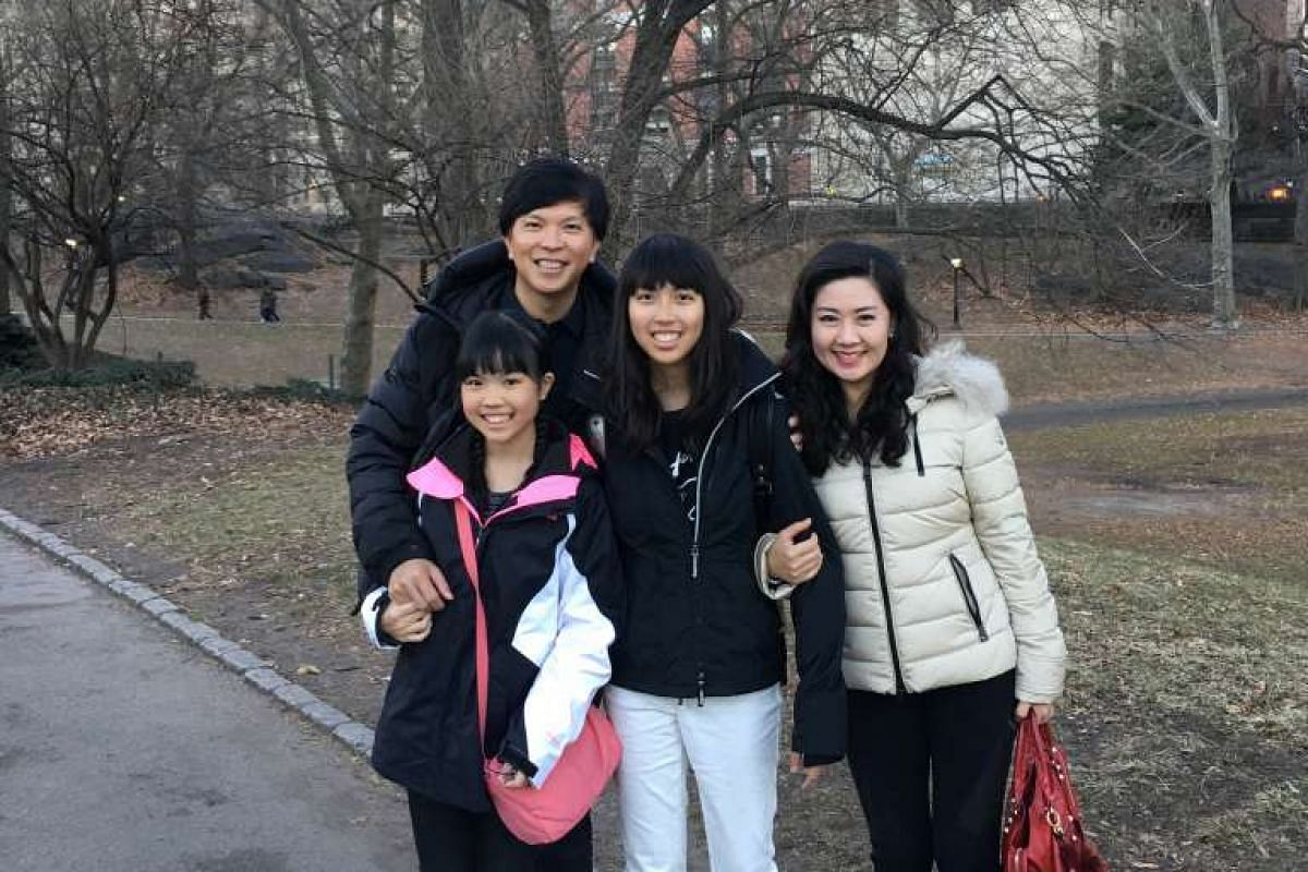 Mr Gary Loh, his wife Selena Cheng and their daughters – Stephanie (left) and Sarah.